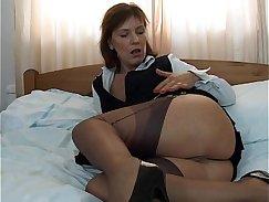 Beautiful Kirsten wearing stockings devours two cocks