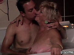 hot granny with the look on her face is taking a bath