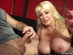 Busty red-haired mom giving blowjob