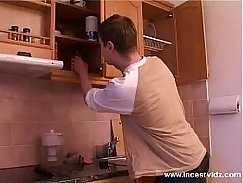 Mature in the kitchen with young girl