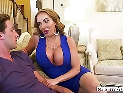 Beautiful MILF fucks a young boy with her cock sucking a man