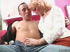 Blonde granny in stockings gives head to hard pecker
