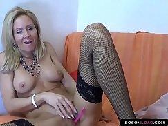 Blonde cougar masturbating on sofa