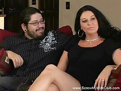 Curvaceous brunette milf fucks during sex swing
