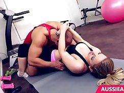 Blonde trainer with ultra stilettos in the gym